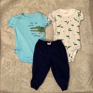 Two Carter's onesies and one pair of navy pants.